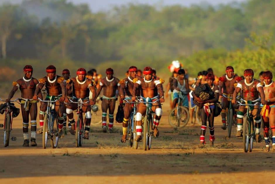 Brazilian Awati indians biking in the Amazon rainforest