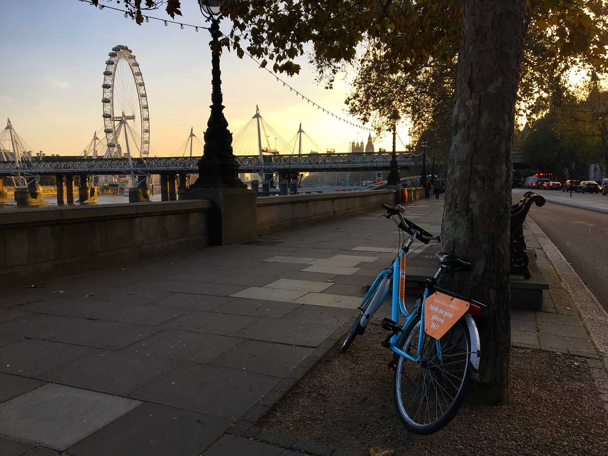 Bicycle by River Thames in London, London Eye in the background