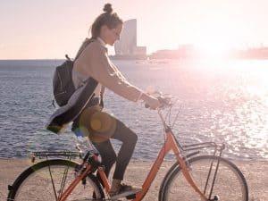 Barcelona beach girl Donkey Republic bike rental